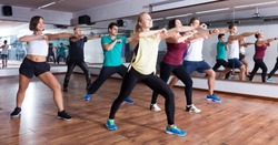 Active men and ladies dancing  at lesson