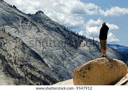 Active middle aged man observing Yosemite national park