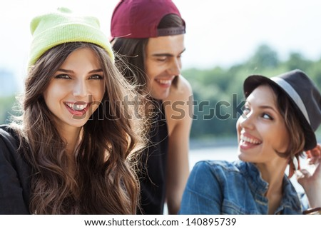 Active people. Closeup of group of young two women and one man. Outdoors, lifestyle