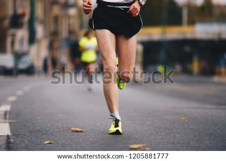 Active people running autumn fall marathon race in the city downtown. Healthy lifestyle. Weight Loss. Autumn fall urban marathon run #1205881777