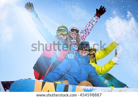 Active people with snowboards outdoors