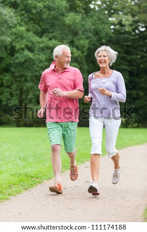 Active senior couple in the park