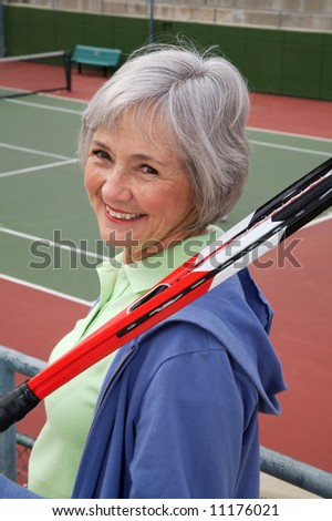Active senior on the tennis court.