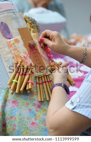 Active senior people workshop with traditional bobbin lace crochet. Hands detail and empty copy space for Editor's text. - Shutterstock ID 1113999599