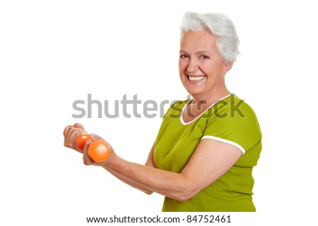 Active senior woman at fitness training with dumbbells
