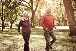 Active seniors couple having recreation together in park.