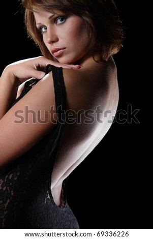 active sexy girl on black background