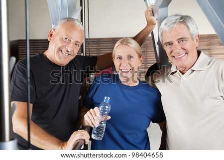 Active smiling senior fitness group in a gym - stock photo