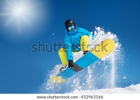 Active snowboarder in the air hitting a jump #432963166