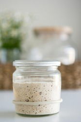 Active sourdough starter in glass jar for sourdough bread
