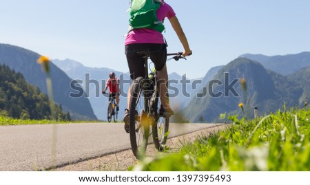 Active sporty woman riding mountain bike in the nature, Slovenia. #1397395493