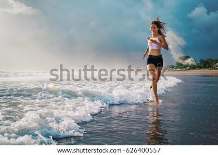 active sporty woman run along...