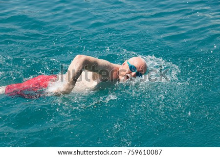 Active swimming. Seventy-year-old man actively swims. Concept: active elderly people. #759610087