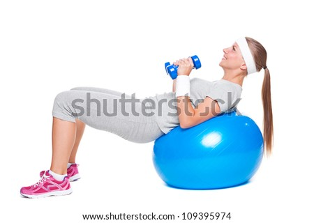 active woman doing exercises with ball and dumbbells. isolated on white background