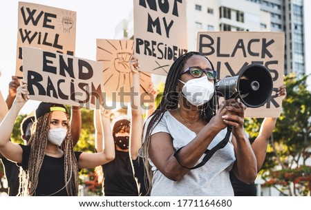 Activist movement protesting against racism and fighting for equality - Demonstrators from different cultures and race protest on street for equal rights - Black lives matter protests city concept ストックフォト ©