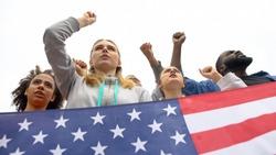 Activists chanting nationalist slogans holding US flag, democratic voting right