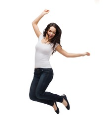 activity and happiness concept - smiling teenage girl in white blank t-shirt jumping