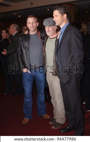 Actor DANIEL CRAIG (left) & director STEVEN SPIELBERG & actor ERIC BANA at an industry screening for their new movie Munich. December 20, 2005.  Beverly Hills, CA  2005 Paul Smith / Featureflash