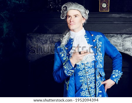 actor dressed as an aristocrat from the eighteenth century wearing a wig Сток-фото ©