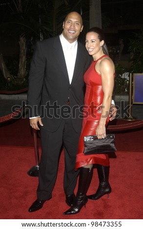 Actor DWAYNE JOHNSON, aka THE ROCK, & wife at the world premiere of his new movie The Rundown at Universal Studios Hollywood. Sept 22, 2003  Paul Smith / Featureflash