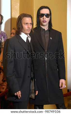 Actor JOHNNY DEPP (left) & rock star MARILYN MANSON at the Los Angeles premiere of Depp's new movie From Hell. 17OCT2001  Paul Smith/Featureflash