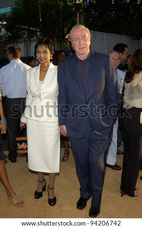 Actor MICHAEL CAINE & wife SHAKIRA at the Hollywood premiere of his new movie Austin Powers in Goldmember. 22JUL2002.   Paul Smith / Featureflash