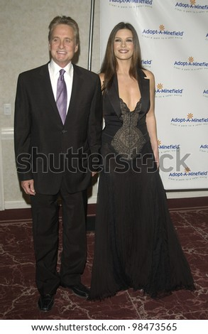 Actor MICHAEL DOUGLAS & wife actress CATHERINE ZETA-JONES at the 3rd Annual Adopt-A-Minefield Benefit Gala at the Beverly Hills Hilton. Sept 23, 2003  Paul Smith / Featureflash