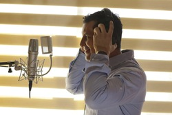Actor performing a dubbing scene in a professional studio.