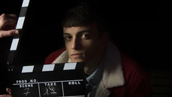 Actor ready for the ciak cinema scene during the production of short film in the night. Man inside a film set before the ciak