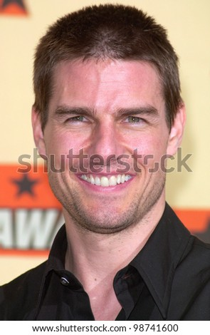 Actor TOM CRUISE at the MTV Movie Awards in Los Angeles. He won the award for Best Male Performance for Mission Impossible 2. 02JUN2001.