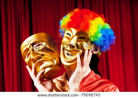 Actor with masks in a funny theater concept