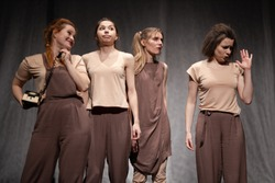 Actors and actresses play a modern lyrical performance of the show on the stage of the theater