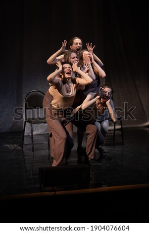 Actors and actresses play a modern lyrical performance of the theater stage show
