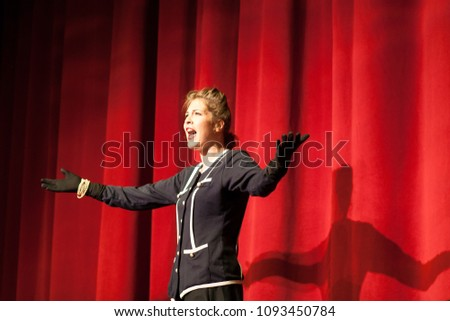 actress acting on stage #1093450784