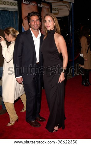 Actress ELIZABETH BERKELEY & boyfriend at the world premiere, in Los Angeles, of What Women Want. 13DEC2000.   Paul Smith / Featureflash - stock photo
