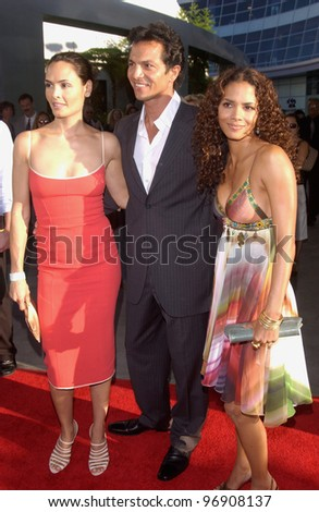 Actress HALLE BERRY (right) with actor BENJAMIN BRATT & wife actress TALISA SOTO at the world premiere, in Hollywood, of their new movie Catwoman. July 19, 2004