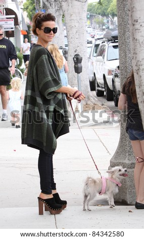 Actress Kate Beckinsale walking with her dog in Brentwood.  July 31, 2010  Los Angeles, CA Picture: Vinicius / Featureflash