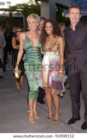 Actresses HALLE BERRY (right) & SHARON STONE & actor LAMBERT WILSON at the world premiere, in Hollywood, of their new movie Catwoman. July 19, 2004