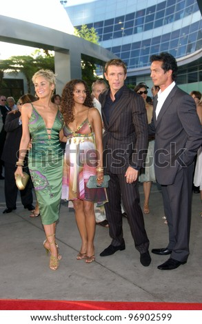 Actresses HALLE BERRY (right) & SHARON STONE & actors LAMBERT WILSON & BENJAMIN BRATT (right) at the world premiere, in Hollywood, of their new movie Catwoman. July 19, 2004