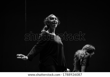 Actresses on stage in rehearsals, opposites, happiness and anguish. Black and white photography. Stock fotó ©