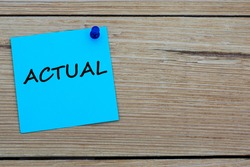 ACTUAL is an word written on a blue sheet attached to a wooden board. Busines concept. Keep it simple concept