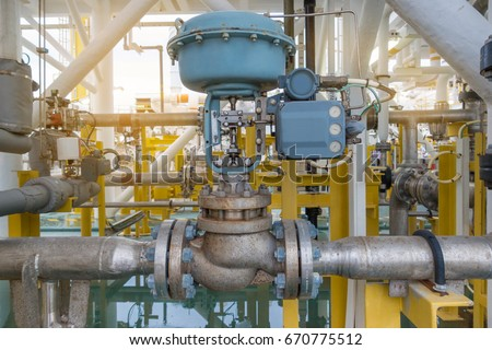 Actuated control valve fail to open type with valve positioner control by programmable logic controller (PLC) to controlling oil and gas conditioning process.