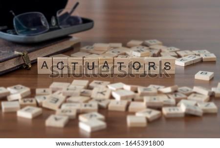 actuators concept represented by wooden letter tiles Foto stock ©