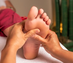 Acupressure, reflexology. Natural medicine, reflexology, acupressure foot massager oppresses energy flow points