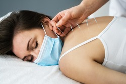 Acupuncture Massage Therapy Treatment In Face Mask
