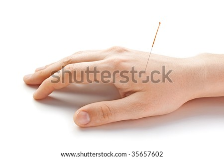 Acupunctured hand on the white background