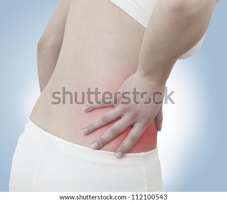 Acute pain in a woman abdomen. Female holding hand to spot of Abdomen-ache. Concept photo with Color Enhanced skin with read spot indicating location of the pain.
