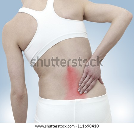 Acute pain in a woman back. Concept photo with Color Enhanced skin with read spot indicating location of the pain.