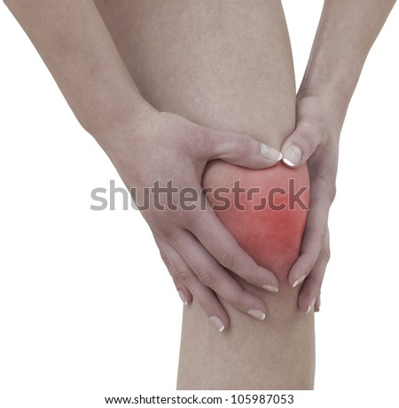 Acute pain in a woman  knee. Female holding hand to spot of knee-aches.