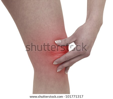 Acute pain in a woman  knee. Female holding hand to spot of knee-aches. Concept photo with Color Enhanced skin with read spot indicating location of the pain. Isolation on a white background.
